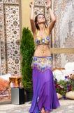 Girl on background of carpet Arab style Stock Photos