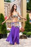 Girl on background of carpet Arab style Royalty Free Stock Photo