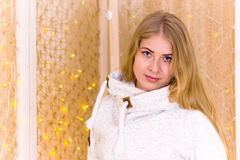 Girl on the background of Christmas garland. Stock Photos
