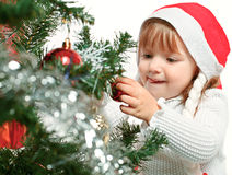 girl on a background of the Christmas tree Royalty Free Stock Image