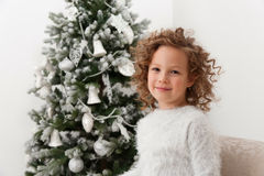 Girl on background of Christmas tree Stock Photos