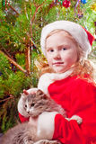 Girl on background chtristmas tree Stock Photo