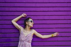 Girl on the background of a colored wall. royalty free stock photo