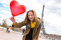 Girl on the background of the Eiffel Tower Royalty Free Stock Photography