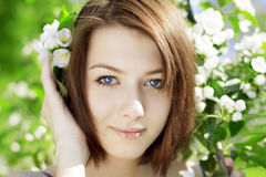 Girl on a background of flowering trees Stock Photo