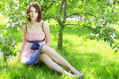 Girl on a background of flowering trees Royalty Free Stock Photos