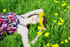 Girl on a background of flowering trees Royalty Free Stock Photo
