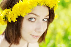 Girl on a background of flowering trees Stock Photography