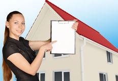 The girl on background of house holding clip board Stock Images