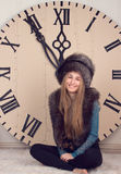 Girl on a background of huge clock Royalty Free Stock Photo