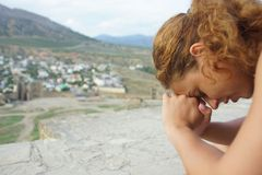 Girl on a background of mountains in the afternoon. royalty free stock photography