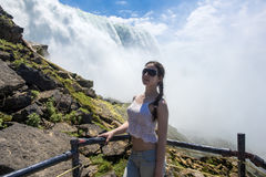 girl on background Niagara Falls Royalty Free Stock Image
