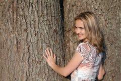 Girl on background of the oak Stock Image