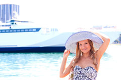 The girl on the background of the ocean liner Royalty Free Stock Image