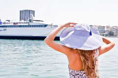 The girl on the background of the ocean liner Stock Image