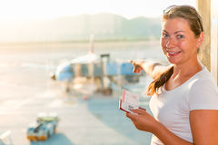 Girl on the background plane Stock Photography