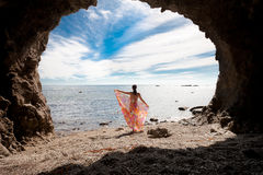 Girl on the background of the sea and clouds Stock Images