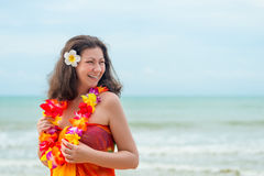 Girl on the background of the sea in pareo and traditional Hawai Royalty Free Stock Image
