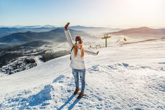 The girl on the background of the ski slopes. Girl in masks for snowboarding rejoice amid the ski slopes Stock Photography