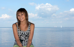 Girl on background sky, sea and sailfish Royalty Free Stock Photography