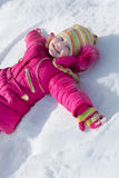 Girl on background snow Royalty Free Stock Photo