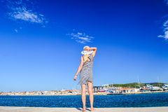 The Vodice cityscape. Girl on the background of Vodice cityscape, Croatia stock images