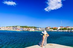 The Vodice cityscape. Girl on the background of Vodice cityscape, Croatia stock photography
