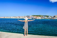 The Vodice cityscape. Girl on the background of Vodice cityscape, Croatia royalty free stock photo