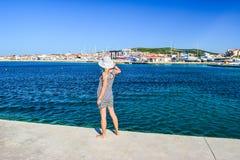 The Vodice cityscape. Girl on the background of Vodice cityscape, Croatia stock photo