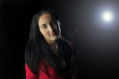 Girl in backlight. Beautiful girl in lens flare Royalty Free Stock Image