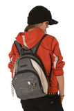 Girl with a backpack. The girl the teenager. In red clothes, in a black knitted cap Stock Photo