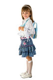 The girl with a backpack. The little girl in a jeans skirt  with a backpack Stock Photography