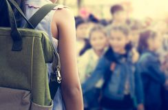 Girl with backpack attend school activities. Royalty Free Stock Images