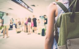 Girl with backpack entering in the airport. Stock Photos