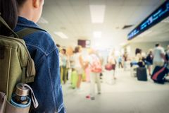 Girl with backpack entering to the airport. Royalty Free Stock Image