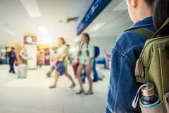 Girl with backpack entering to the airport. Stock Photo