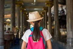 Girl with backpack entering to buddhist temple at Wat Tham Seua, Royalty Free Stock Photos