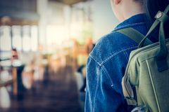 Girl with backpack entering to the classroom. Stock Photos