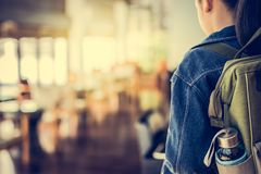 Girl with backpack entering to the classroom. Stock Image