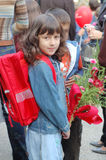 Girl with backpack and flowers Stock Photos