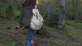 Girl with a backpack in the forest stock video footage