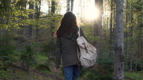 Girl with a backpack in the forest.  stock footage