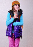 Girl with backpack and hat drinking cola Royalty Free Stock Image