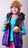 Girl with backpack and hat drinking cola Royalty Free Stock Photos
