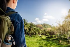 Girl with backpack hiking in countryside. Royalty Free Stock Photos