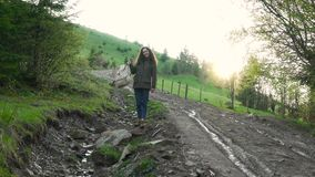 Girl with backpack on the hill stock footage