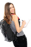 girl with a backpack, holds the book Royalty Free Stock Images