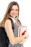 girl with a backpack, holds the book Royalty Free Stock Photo