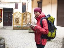 Girl with a backpack and a map. Stock Photography