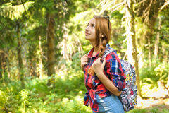 Girl with backpack in mountain. Stock Photography